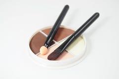 Set of eyeshadows and brushes Stock Photo