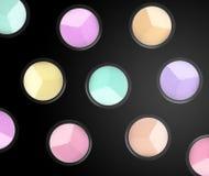 Set of eyeshadows and brushes on black background Stock Photos