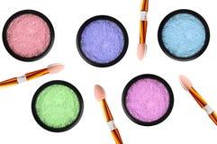 Set of 5 eyeshadows and brushes isolated on white Royalty Free Stock Images