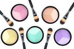 Set of 5 eyeshadows and brushes isolated on white background Stock Images