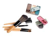 Set of eyeshadows and brushes isolated on white background. Royalty Free Stock Images
