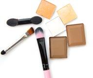 Set of eyeshadows and brushes isolated on white background. Royalty Free Stock Image