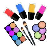 Set of 5 eyeshadows, brushes and nailpolishes isolated Stock Photo