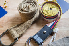 Set of fabric belt and label on wood background Royalty Free Stock Images