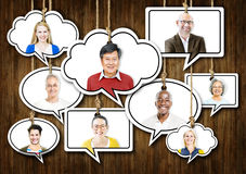 Set of Faces on Hanging Colourful Speech Bubbles Royalty Free Stock Photos