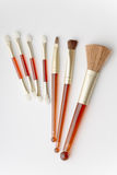 Set of facial brushes. Cosmetic facial brushes and eyeshadows applicators on white background royalty free stock photo