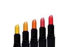 Set Farbenlippenstifte Lippenstiftsatz lokalisiert Stockbilder
