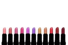 Set Farbenlippenstifte Lippenstiftsatz lokalisiert auf weißem backgroun Lizenzfreies Stockfoto