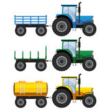 Set of farm tractors with wagons. Royalty Free Stock Images