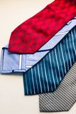 Set of fashion multicolored man`s ties. Red blue gray and striped ties on the white background. Colored man`s neckties for the Father`s Day. Studio Photo stock photo