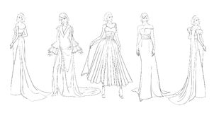 A set of fashion sketches. Autumn-winter 2018. Fashion girls on a white background in beautiful evening dresses Royalty Free Stock Images