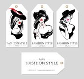 Set of fashion tags with beautiful black and white women wearing hats, sketch style, Paris, London, Milan business card, beauty gi. Rls hand drawn  illustration Royalty Free Stock Photos