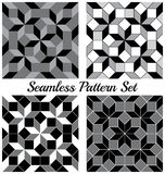 Set of 4 fashionable geometric seamless patterns with rhombus and squares of black, grey and white shades Royalty Free Stock Photo