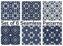 Set of 6 fashionable geometric seamless patterns with triangles. Set of 6 abstract fashionable geometric seamless patterns with triangles and squares of blue Royalty Free Stock Photography