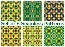 Set of 6 fashionable geometric seamless patterns with triangles and squares of green, blue, orange and yellow shades Royalty Free Stock Photos