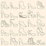 Set of 25 fashionable linear shoes. Set of 25 fashionable line art shoes Stock Photos