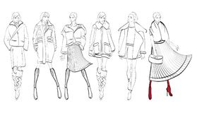 A set of fashionable sketches. Autumn-winter 2018. Fashionable girl on a white background Royalty Free Stock Photo