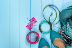 Set of fashionable women's acsessories on blue wooden background Royalty Free Stock Photography
