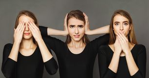 Series of young woman portraits at gray background stock images