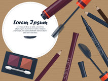 Set of female cosmetics for the eyes on a table with space for your advertising. Vector Stock Photography