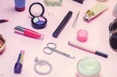 A set of female cosmetics, fashion, style, accessories, glamor, elegance. top view flat lay. A set of female cosmetics, fashion style accessories glamor Royalty Free Stock Images