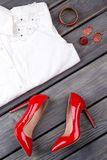 Set of female elegant attire. Women white shirt, red stilettos and jewelry. Collection of feminine modern outfit Stock Images