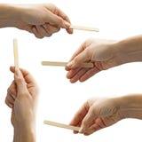Set of  female hands holding empty ice cream stick Royalty Free Stock Photo