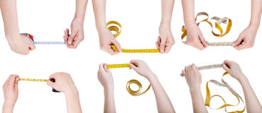 Set of female hands with measuring tapes. Isolated on white background Royalty Free Stock Photography