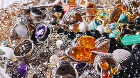 A set of female jewelry. Background of various jewelry, slowly rotating. 4K video stock video