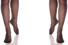Set female legs feet in stockings kapron pantyhose different sides. On white background isolation Royalty Free Stock Image