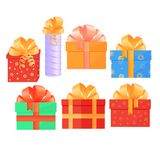 A set of festive boxes with gifts tied with satin bows. A set of festive boxes with gifts tied with satin bows Stock Images