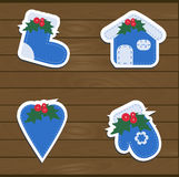 Set a festive childrens Christmas stickers. New year collection blue templates, labels and badges for decoration or congratulations gift. There are mittens Royalty Free Stock Photo
