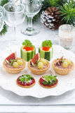 Set of festive Christmas mini appetizers, vertical Royalty Free Stock Photo