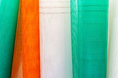 A set of fiberglass netting reinforcing mesh rolled up in a roll for the insulation of walls. A set of fiberglass netting reinforcing mesh rolled up in a roll royalty free stock photography