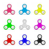 Set of fidget spinners. Set of colorful fidget spinners with different colors Very popular toy for distress relief. 3d render illustration Royalty Free Stock Image
