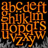 Set of Fiery letters isolated. On a black background Royalty Free Stock Photo