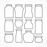 Set of figured glass jars Royalty Free Stock Photos