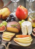 Set of fine cheeses with fruit and honey Royalty Free Stock Images