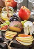 Set of fine cheeses with fruit and honey Royalty Free Stock Photo