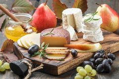 Set of fine cheeses with fruit and honey Stock Images