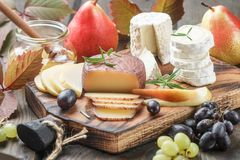 Set of fine cheeses with fruit and honey Stock Photo