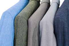 Set of finished jackets on hangers in close up Stock Image