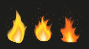 Set of fire flames of various size with sparks on black background Royalty Free Stock Photography