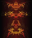 Set of fire ornaments. Decorative ornaments with tribal art elements Stock Photos