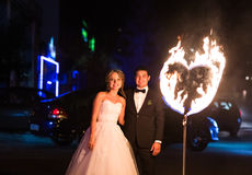 Set fire to the couple on their wedding heart Royalty Free Stock Image
