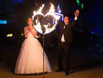 Set fire to the couple on their wedding heart Stock Photo