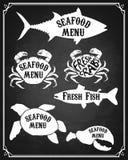Set of Fish silhouette. Seafood menu design elements. Stock Image