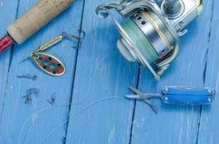 Set of fisherman. Spinning, fishing reel, spool and scissors. Fishing set Stock Photo