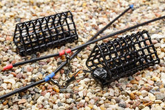 Set of fishing feeding troughs for catching by a feeder on stony ground Stock Image