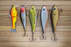 Set Of Fishing lures on wooden desk Stock Photos